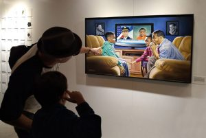 """At Museum of Broken Windows, a white father explaining Michael D'Antuono's painting, """"The Talk"""" to his son"""